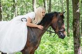 Bride on horseback — Stock Photo