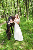 Bride and horse — Stock Photo