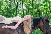 Pretty girl on horseback — Stock Photo
