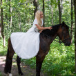 Bride on horseback — Stock Photo