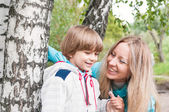 Mother and son in the forest — Stock Photo