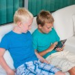 Two boys playing on touchscreen tablet computer — Stock Photo