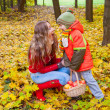 Stock Photo: Happy family with colorful umbrellin autumn park