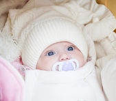 Adorable baby girl wearing winter hat — Stock Photo