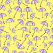 Stock Vector: Pattern with umbrellas on yellow background