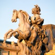 The Louvre Palace and Equestrian statue of Louis XIV before sunset, Paris, France — Foto Stock
