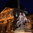 Night view of The Louvre Palace and the Pyramid, Paris, France — Stock Photo #12854278