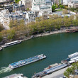 Tourist boat swimming  Seine - aerial view from Eiffel Tower, Pa - 