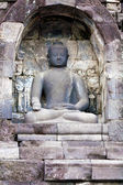One of 504 Buddha statues of Borobudur Buddhist temple (IX cent.), UNESCO World Heritage Site, Magelang, Java, Indonesia — Stock Photo