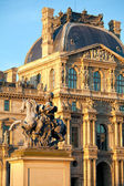 The Louvre Palace and Equestrian statue of Louis XIV before sunset, Paris, France — Stock Photo
