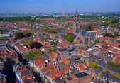 View from Nieuwe Kerk (New Church) (1383-1510) on Oude Kerk (Old Church) (14th-15th cent.), Delft, Netherlands — Stock Photo