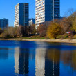 Apartment buildings mirrored in pond at autumn, Chertanovo Yuzhn — Stock Photo