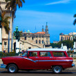 Vintage red car on the street of old city, Havana, Cuba - Stock Photo
