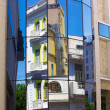 Old building mirrored in modern house window, Havana - Stock Photo