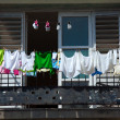 Fresh laundry on the balcony of old home, Havana, Cuba - Stock Photo
