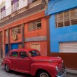 Vintage red car on the street of old city, Havana, Cuba — Stock Photo #12883623