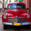Stock Photo: Vintage red car on the street of old city, Havana, Cuba