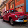 Vintage red car on street of old city, Havana, Cuba — Stock Photo #12883626