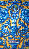 Vintage Porcelain tile оf 19th. century on the wall of old buil — Stock Photo