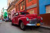 Vintage red car on the street of old city, Havana, Cuba — Stok fotoğraf