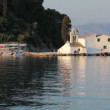 Sunset scene of Vlacherna monastery, Kanoni, Corfu, Greece - Stock Photo