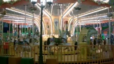 Traditional carousel - pony and horse ride, merry-go-round — Stock Video