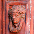 Vintage face on old door, Corfu — Zdjęcie stockowe