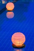 Floating water lantern in the pool — Stock Photo