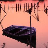 Sunset scene with nets and boat, Kanoni, Corfu, Greece — Stock Photo