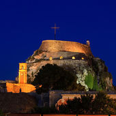 Evening view of illuminated Old fortress, Corfu island, Greece — Stock Photo
