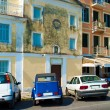 Typical buildings and retro car in old city, Corfu, Greece — Stock Photo