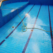 Empty Swimming pool with cleaning tools in the bottom — Stock Photo