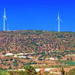 Panorama of Wind turbines generating electricity - Stock Photo