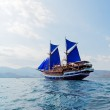 Vintage Wooden Ship with Blue Sails — Stock Photo #13761680