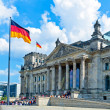Reichstag Building and German Flag, Berlin — Stock Photo #13966746