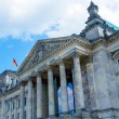 Reichstag Building and German Flag, Berlin - Stok fotoraf