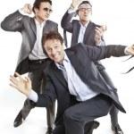 Crazy businessmen dancing — Stock Photo #13338561