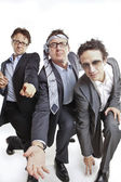Crazy businessmen dancing — Stock Photo