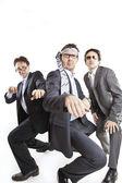 Crazy businessmen dancing — Stock Photo