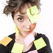 Pretty young girl with post it notes — Stock Photo #13611311