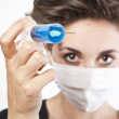 Young pretty nurse in mask with syringe — Stock Photo #13611322