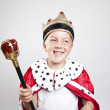 Royalty-Free Stock Photo: Little funny boy dressed as a king