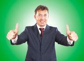 微笑着竖起大拇指与商人 — 图库照片