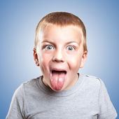 Little naughty boy portrait sticking out his tongue — Stock Photo