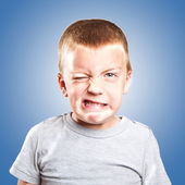 Little naughty boy portrait funny face expression — Stock Photo