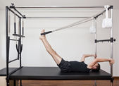 Man practicing pilates — Stock Photo