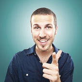 Portrait of happy young manpointing at you — Stock Photo