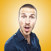 Portrait of a young beautiful man surprised face expression — Foto Stock