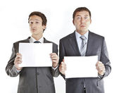 Business couple holding blank signs — Stok fotoğraf