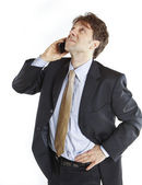 Businessman speaking mobile phone — Stock Photo